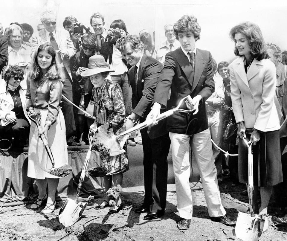 Tree generations of Kennedys dug small scoops of muddy soil during the groundbreaking ceremonies: from left, Caroline Kennedy, Rose Kennedy, Senator Edward Kennedy, John Kennedy Jr., and Jacqueline Kennedy Onassis.